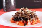 Ensalada templada de arroz negro y confit de pato